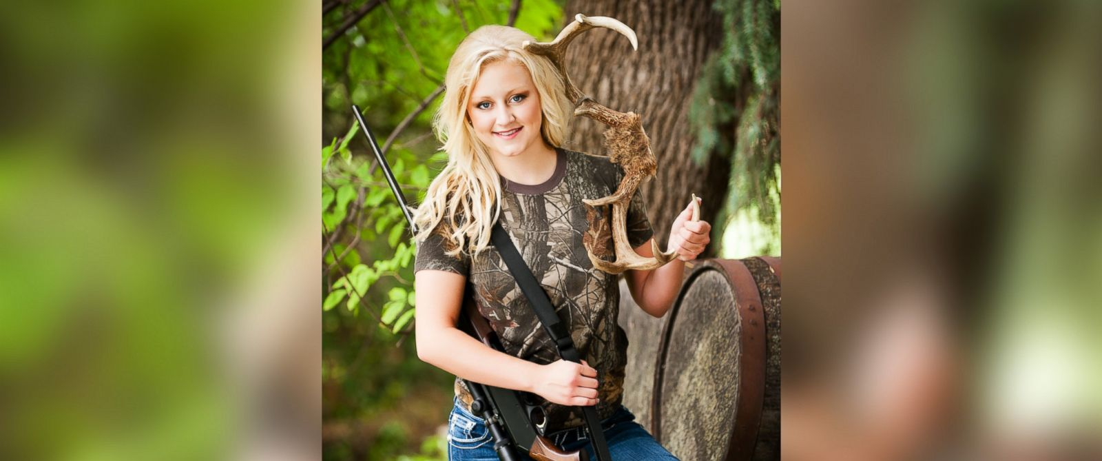 PHOTO: Jillian Dixson of Grand Island incorporated her rifle and a trophy with her senior portrait.