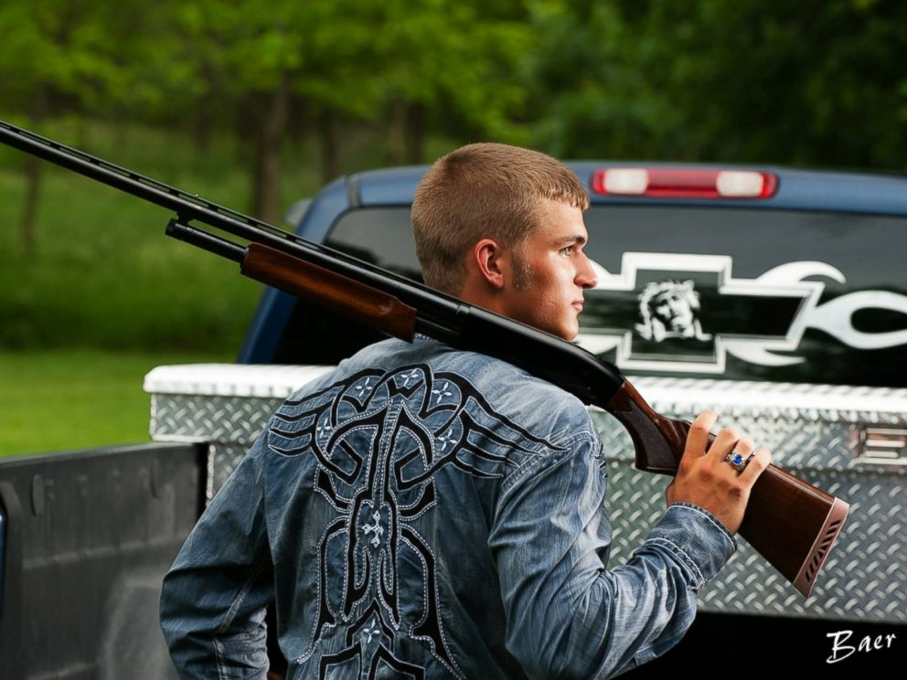 PHOTO: Dustin Langenberg of Bertrand, Neb. poses with a gun and a Ford truck.