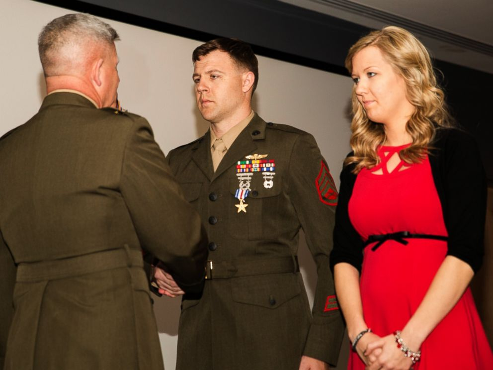 PHOTO: Major Gen. Joseph L. Osterman, commander, U.S. Marine Corps Forces, Special Operations Command, awards Staff Sgt. Andrew C. Seif the Silver Star Medal during a ceremony at Stone Bay aboard Marine Corps Base Camp Lejeune, N.C., March 6, 2015.