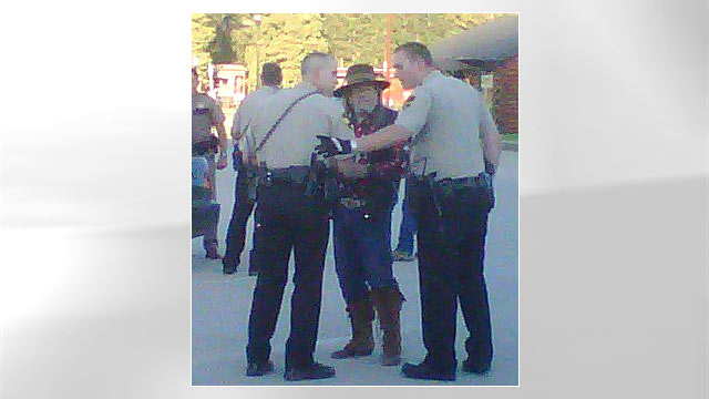 PHOTO: Pennington County deputies question people at the scene of the Wild West-style shootout in Hill City, South Dakota June 17, 2011.