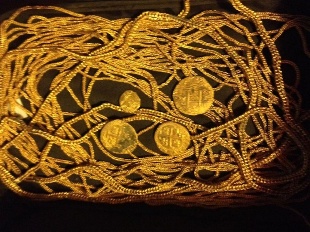 PHOTO: Gold chains and coins Eric Schmitt discovered at the same shipwreck last year.