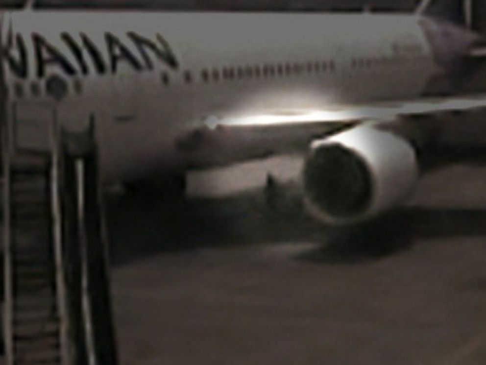 PHOTO: Surveillance video shows a California teenager who hid in the wheel well of a Hawaiian Airlines plane at Mineta San Jose International Airport in April, 2014.