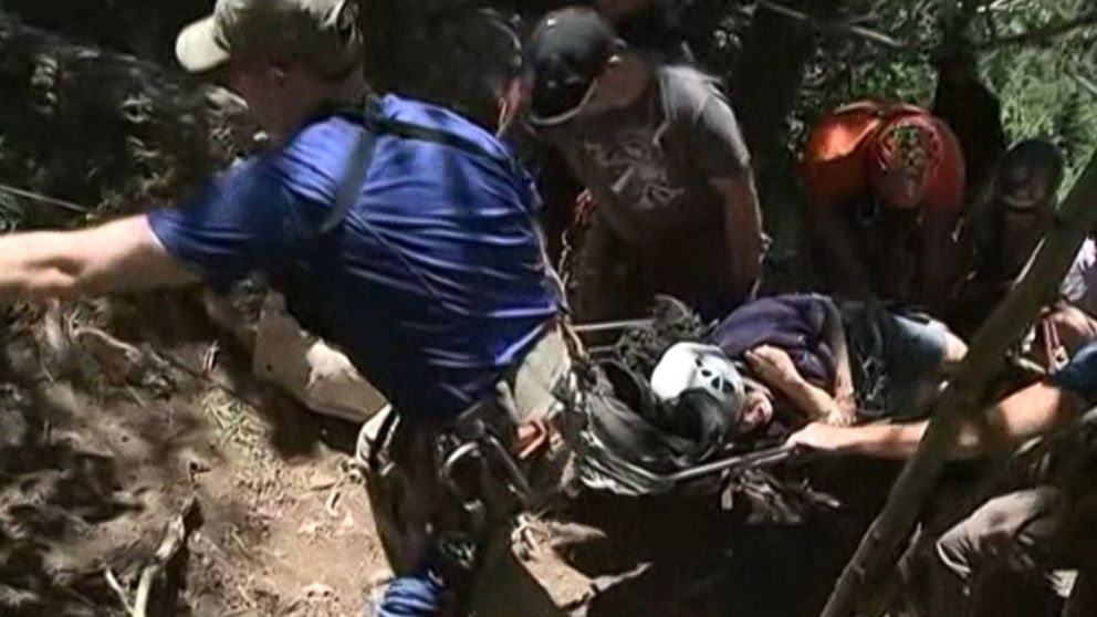 New Mexico rescuers rappelled down steep and rocky terrain to retrieve the woman who fell 30 feet.