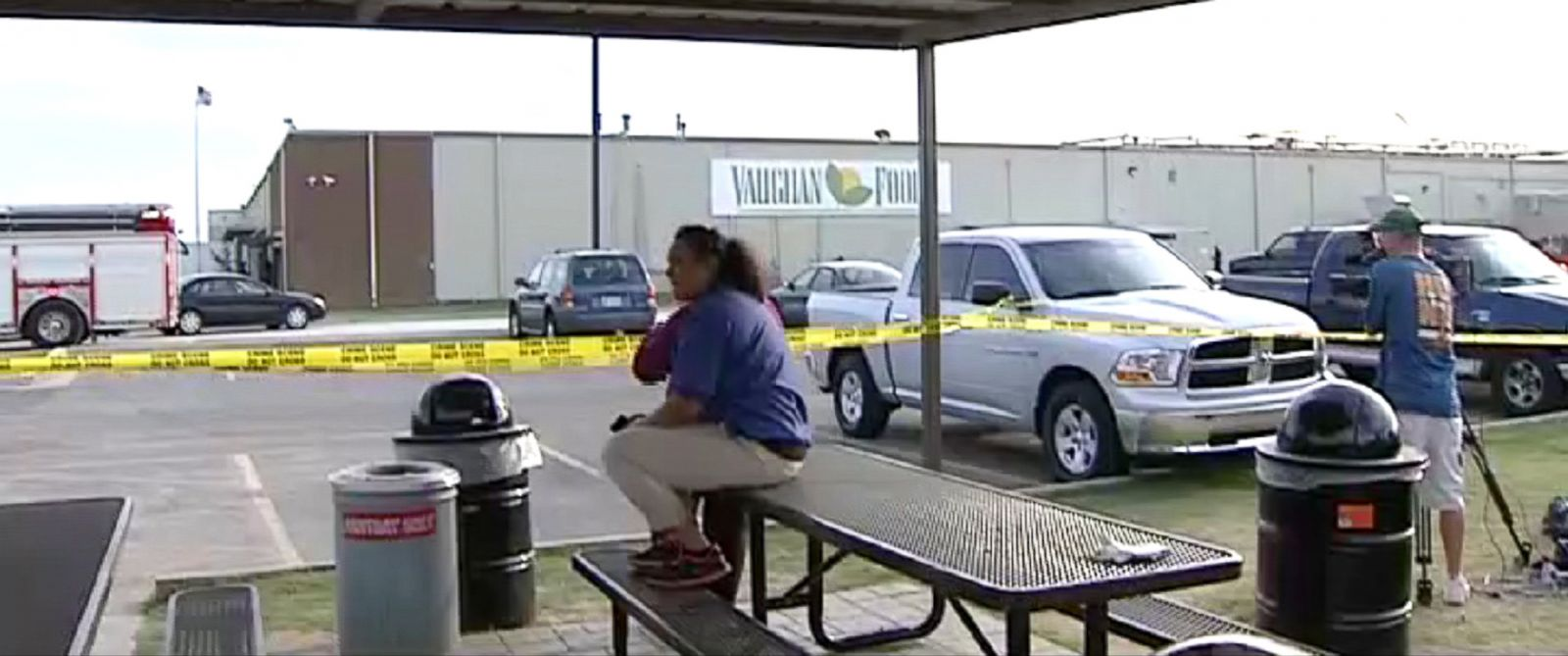 PHOTO: People wait outside of Vaughan Foods in Moore, Okla. where a woman was stabbed to death on Sept 25, 2014.