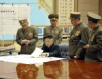 PHOTO: An unverified photo released by KCNA news agency on March 29, 2013 shows top leader of the Democratic People s Republic of Korea (DPRK) Kim Jong Un (seated) attending an urgent meeting with top military officials; Un has reportedly ratified a strik