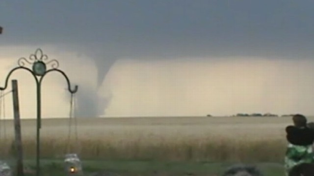 VIDEO: Caleb and Candra Pence celebrate their wedding with a tornado in the background.