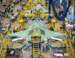 PHOTO:Workers can be seen on the moving line and forward fuselage assembly areas for the F-35 Joint Strike Fighter at Lockheed Martin Corps factory located in Fort Worth, Texas, Oct. 13, 2011.