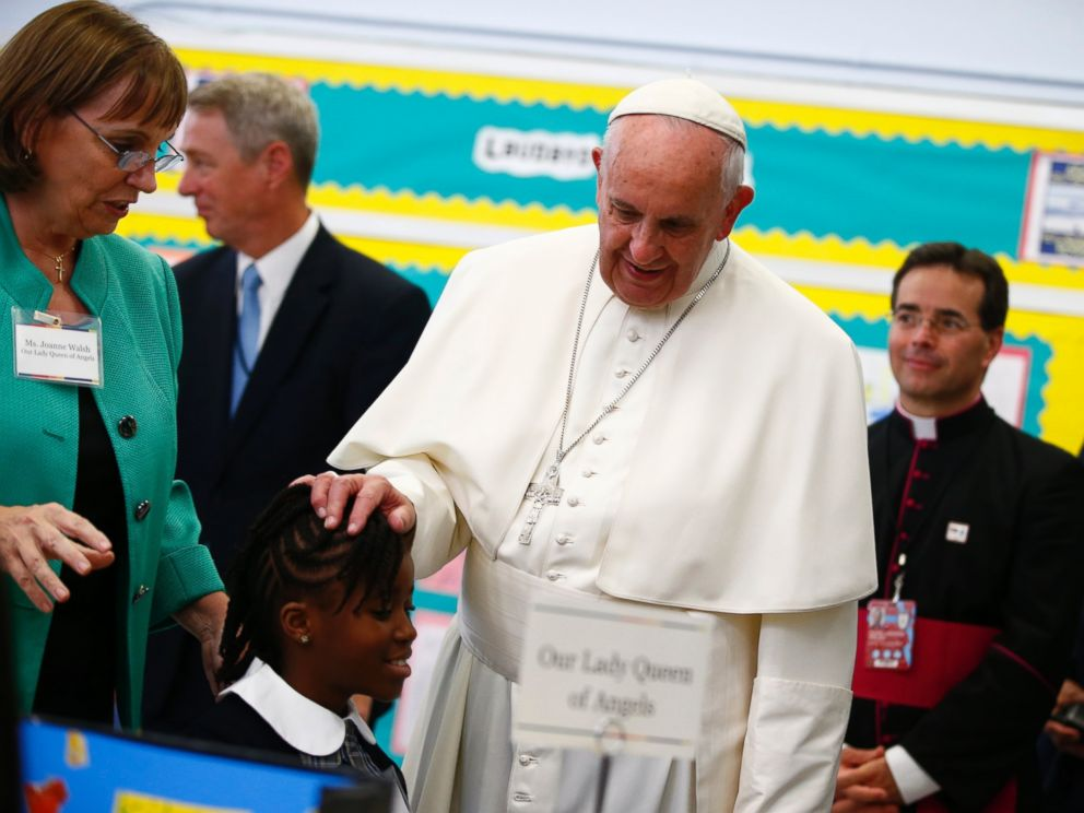 PHOTO: Pope Francis touches a students head as he visits Our Lady Queen of Angels School in East Harlem in New York, Sept. 25, 2015.