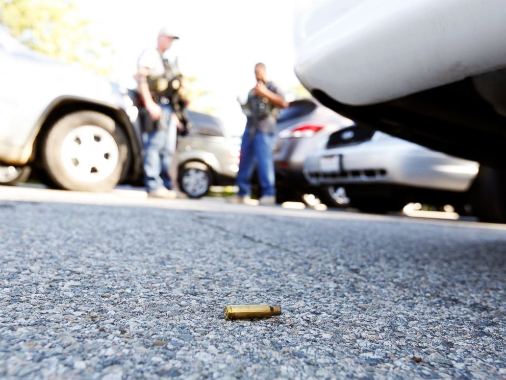 PHOTO: A spent cartridge lies on the ground as police officers secure the area after at least one person opened fire at a social services agency in San Bernardino, Calif., Dec. 2, 2015.