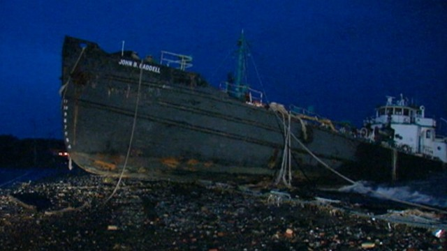 VIDEO: The storm surge moved a 170-foot-long tanker to land in Staten Island, New York.