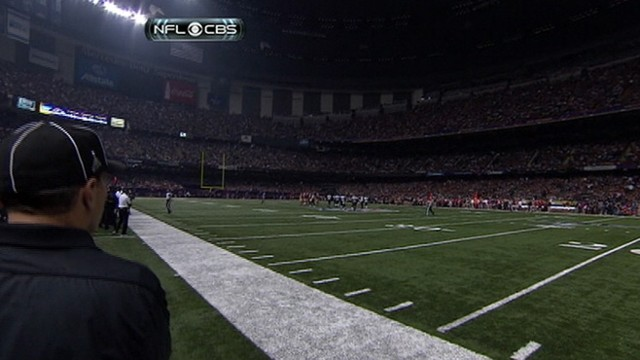 VIDEO: Power outage leaves biggest football game of the year in the dark for about half an hour.