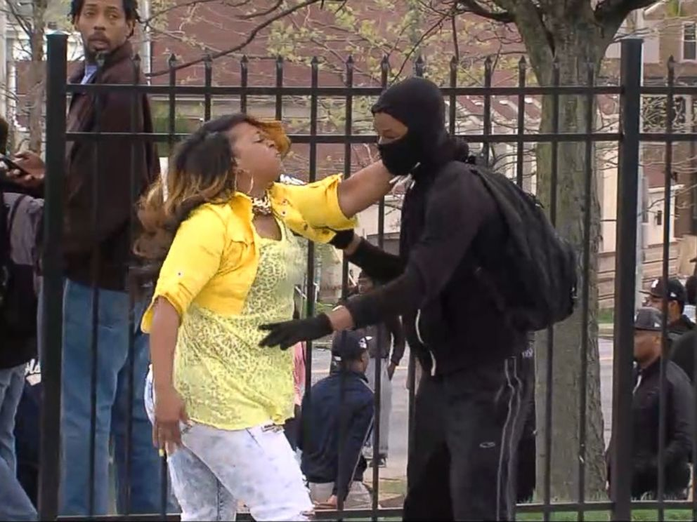 PHOTO: Toya Graham smacks her son, Michael Singleton, after finding him in the street during the violent demonstrations in Baltimore, April 27, 2015.