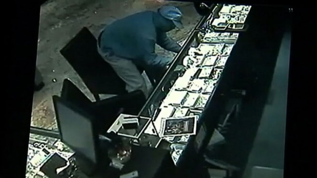 VIDEO: Three masked men made off with the stolen goods in just over one minute.