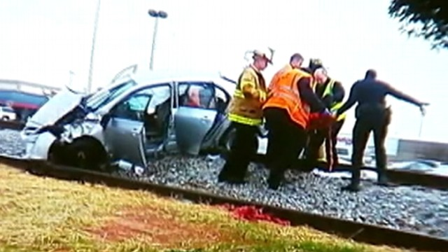 VIDEO: The pregnant drivers car flipped over before landing on railroad tracks in Georgia.