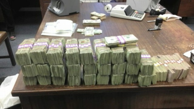 VIDEO: Police investigate source of money stashed in secret compartment of drivers car.