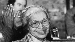 PHOTO: Civil rights leader Rosa Parks smiles while people gathered around her applaud at a ceremony held in her honor at the House of the Lord Church, Brooklyn, New York on Jan. 22, 1988.