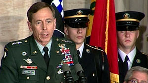 PHOTO General David H. Petraeus, right, speaks to 120 World War II veterans who helped liberate the Nazi concentration camps