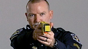Photo: Powerful New Tasers Creating Controversy Following Recent Deaths. Weapons Carry Three Times the Sting; Prompt Safety Questions