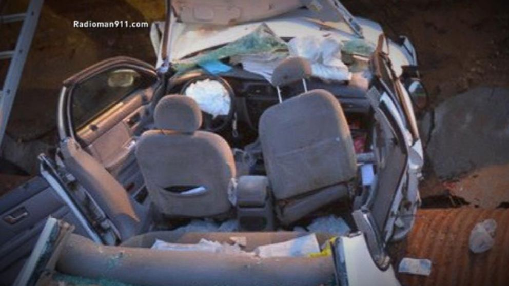 VIDEO: 911 Call: Mother and Son Drive Into a Sink Hole