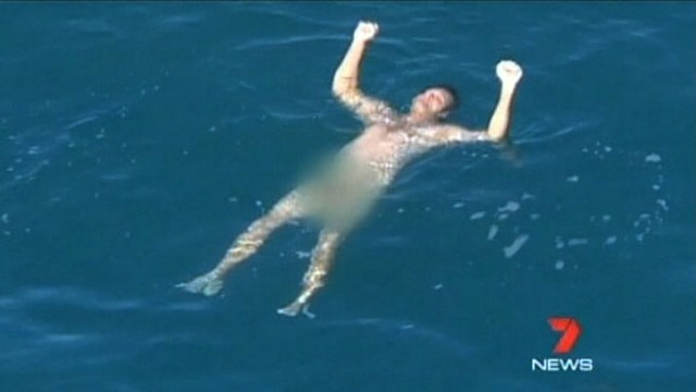 VIDEO: A fisherman in Australia is circled by a hammerhead shark.