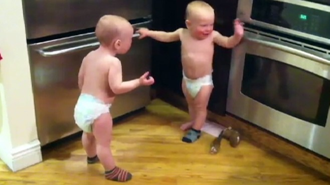 VIDEO: The web is abuzz about what two twin babies could possibly be talking about.