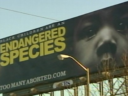 VIDEO: The signs combine the contentious issues of race and abortion in Atlanta.