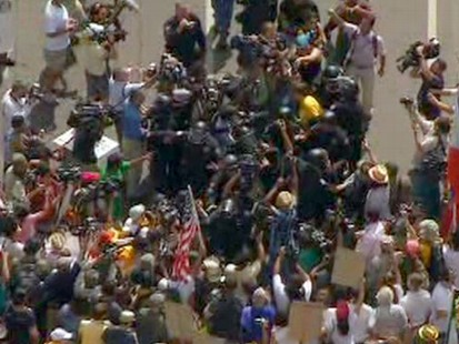 VIDEO: Protests continue a day after a federal judge put the law on hold.