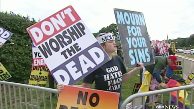 VIDEO: Demonstrators line up outside the church for tomorrow?s ceremony.