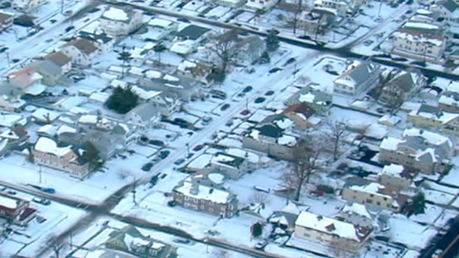VIDEO: An old industrial community has trouble cleaning up 32 inches of snow.