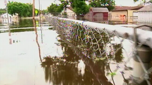 VIDEO: Rising river water breaks through levees, threatens homes and businesses.