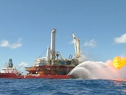 VIDEO: Officials say a new cap could completely contain the oil gushing into the Gulf.