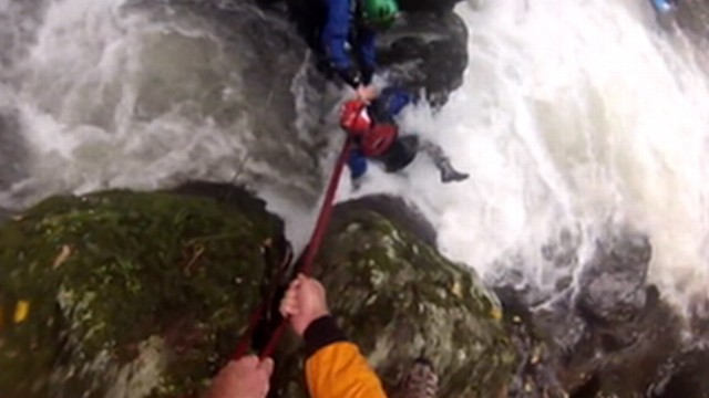 VIDEO: One kayaker is swept down an English channel as friends race against time to save him from drowning.