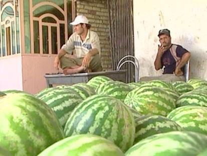 Men and watermelons