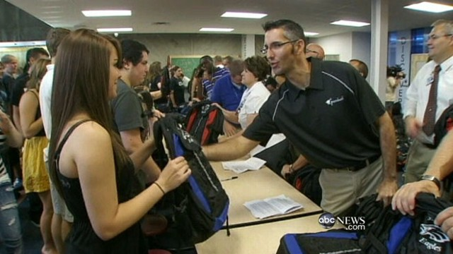 VIDEO: Students return to school three months after deadly twisters.