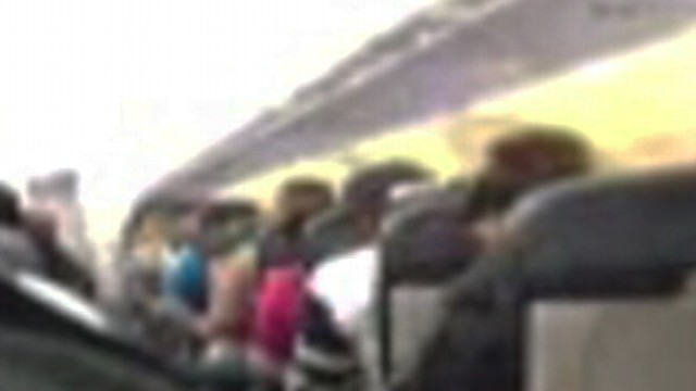 VIDEO:Passengers describe hearing a loud noise and seeing flames on Spirit Airlines flight 165.