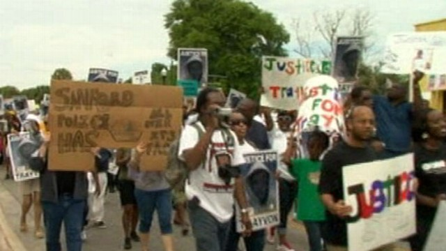 VIDEO: Thousands rally to condemn the shooting of the 17-year-old boy.
