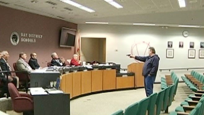 VIDEO: A Florida man upset that his wife was fired opened fire on the school board.