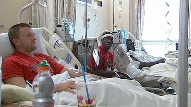VIDEO; Football Team Lands in Hospital