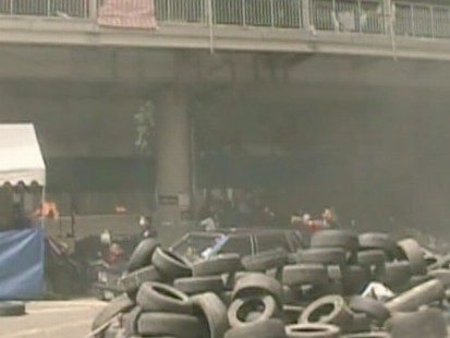 VIDEO: Thai troops stormed anti-government protest camps and opened fire.