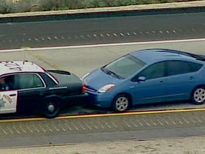 VIDEO: A driver speeds down a San Diego freeway, unable to stop or slow his Prius.