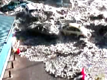 VIDEO: Menacing Tsunami Waves Toss Cars Like Toys
