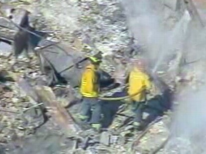 VIDEO: Officials say fire zone still too hot to search; Utility promises answers.