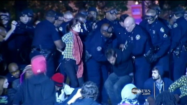 VIDEO: U.S. cities facing budget crises clamp down on protesters.