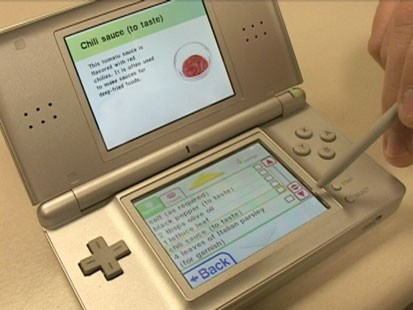 A picture of a Nintendo DS with the game Personal Trainer Cooking on it.