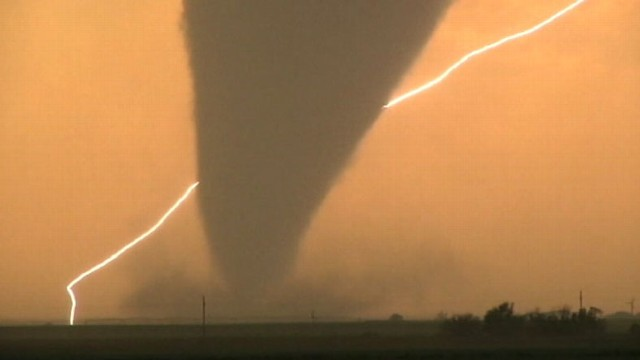 VIDEO: At least four tornadoes touch down in Kansas; heavy rain and winds on its way.