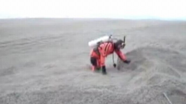 VIDEO: Watch as divers venture into an ash-filled lake in Argentina