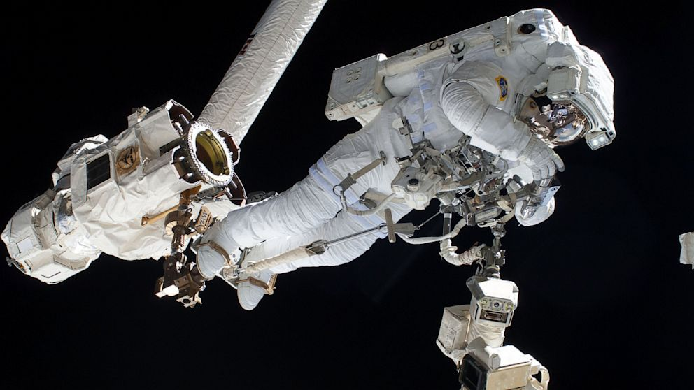 an astronaut goes out for a space walk - photo #28